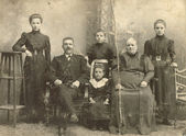 A photo taking in the Russian Empire, shows a family of Russian Germans, man, woman and four children, Ust-Abakan sawmill, a veterinary — Stock Photo