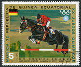 A stamp printed in the Equatorial Guinea, is devoted to the Summer Olympics in Munich-72, Show Jumping, circa 1972 — Stock Photo