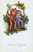 GERMANY - CIRCA 1937: Reproduction of an old postcard, shows happy children and a Christmas decoration, circa 1937. German text: Health in the New Year! — Stock Photo