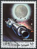 FUJEIRA - CIRCA 1970: A stamp printed in the Fujeira, shows the mission the spacecraft Apollo-13, circa 1970 — Stock Photo