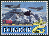 ECUADOR - CIRCA 1995: Postage stamps printed in Ecuador, dedicated to the 75 th anniversary of the Air Force, combat aircraft against the backdrop of the volcano — Stock Photo