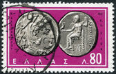 GREECE - CIRCA 1963: A stamp printed in Greece, shows the ancient Greek coins, Alexander the Great, Zeus, Hercules, circa 1963 — Stock Photo