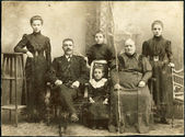 RUSSIAN EMPIRE - CIRCA 1907: A photo taking in the Russian Empire, shows a family of Russian Germans, man, woman and four children, Ust-Abakan sawmill, a veterinary — Stock Photo