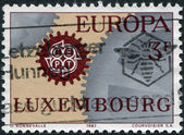 LUXEMBOURG - CIRCA 1967: A stamp printed in Luxembourg, shows Cogwheels and emblem CEPT, circa 1967 — 图库照片