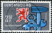 LUXEMBOURG - CIRCA 1960: A stamp printed in Luxembourg, is dedicated to the National Exhibition of Craftsmanship, Luxembourg-Limpertsberg, shows Heraldic Lion — Stock Photo