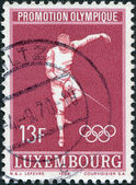 LUXEMBOURG - CIRCA 1968: A stamp printed in Luxembourg, is dedicated to summer Olympic Games in Mexico, is shown Fencing, circa 1968 — Stock Photo