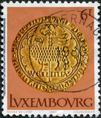 LUXEMBOURG - CIRCA 1980: A stamp printed in Luxembourg, shows gold coin of the time of Wenzel von Luxemburg, Easter lamb, circa 1980 — Zdjęcie stockowe