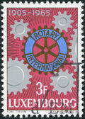 LUXEMBOURG - CIRCA 1965: A stamp printed in Luxembourg, is dedicated to the 60th anniversary of Rotary International, shows Rotary Emblem and Cogwheels, circa 1965 — Stock Photo