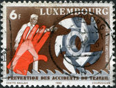 LUXEMBOURG - CIRCA 1980: A stamp printed in Luxembourg, is dedicated to 9th World Congress on Prevention of Occupational Accidents & Diseases, Amsterdam, shows a Man — Stock Photo