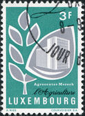 LUXEMBOURG - CIRCA 1969: A stamp printed in Luxembourg, shows Grain and Mersch Agricultural Center, circa 1969 — Stock Photo
