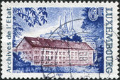 LUXEMBOURG - CIRCA 1980: A stamp printed in Luxembourg, shows State Archives Building, circa 1980 — Stock Photo