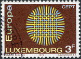 LUXEMBOURG - CIRCA 1970: A stamp printed in Luxembourg, shows Interwoven Threads, circa 1970 — Stock Photo