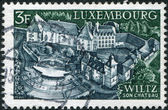 LUXEMBOURG - CIRCA 1969: A stamp printed in Luxembourg, shows Castle and open-air theater, Wiltz, circa 1969 — Stok fotoğraf