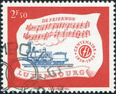 LUXEMBOURG - CIRCA 1959: A stamp printed in Luxembourg, is dedicated to Centenary of Luxembourg's railroads, shows Locomotive A1A n2 of 1859 and Hymn, circa 1959 — Stock Photo