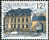 LUXEMBOURG - CIRCA 1987: A stamp printed in Luxembourg, shows Health Center, 18th century, Mersch, circa 1987 — 图库照片