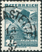 AUSTRIA - CIRCA 1934: A stamp printed in Austria, shows a woodcutter, Mount Kitzsteinhorn, Zeller See (Salzburg), circa 1934 — Stock Photo