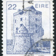 A stamp printed in the Ireland shows Aughnanure Castle, Oughterard, circa 1982 - Stock Photo