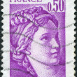 Постер, плакат: A stamp printed in France depicts Sabine fragment by Jacques Louis David circa 1977