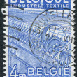 Stock Photo: Stamp printed in Belgium, is dedicated to Textile Industry, circ1948