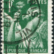A stamp printed in France, depicts the Goddess of the Rainbow Iris, circa 1939 — Stock Photo