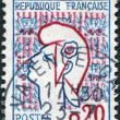 Royalty-Free Stock Photo: A stamp printed in France, depicts Marianne is a national emblem of France, flag and coat of arms, circa 1961