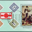 "Photo: Stamp printed in Cuba, is dedicated to PHILATOKYO-81, shows picture of ""Idyll in tehouse"" by Kitagawau Utamaro, circ1981"