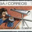 Royalty-Free Stock Photo: A stamp printed in Cuba, is dedicated to Pan American Games in Colombia, shows the bullet shooting, circa 1971
