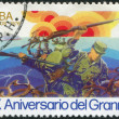Stamp printed in Cuba, is dedicated to 20th anniversary of revolution, shows soldiers with guns, circ1976 — Stock Photo #12162407