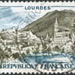 A stamp printed in France, view and Lourdes Rosary Basilica, circa 1958 — Stock Photo