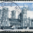 Stock Photo: A stamp printed in France, shows the Laon Cathedral (Cathedrale Notre-Dame de Laon), circa 1960