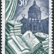 A stamp printed in France, is dedicated to Book manufacture, in the background of the dome of the French Academy, circa 1954 — Foto Stock