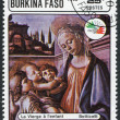 A stamp printed in the Burkina Faso, is devoted to the International Philatelic Exhibition, Italy-85, shows a picture of Botticelli - Stock Photo