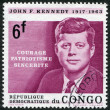 A stamp printed in the Democratic Republic of the Congo, is dedicated to the anniversary of the death of U.S. President John Kennedy, circa 1964 — Stock Photo #12162571