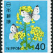 A stamp printed in Japan, shows a flowering rape and butterflies, circa 1980 — Stock Photo #12162636