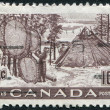 Stock Photo: Postage stamps printed in Canada, depicts Indians Drying Skins on Stretchers, circ1950