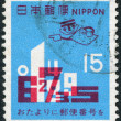 A stamp printed in Japan, dedicated third anniversary of the entry postal codes, shows a combination of numbers, circa 1971 — 图库照片