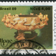 Postage stamps printed in Brazil, shows UPAE emblem and pre-Columbian stone carvings: Ceramic brazier under three-footed votive urn, circa 1989 — Stock Photo