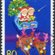 Stock Photo: Stamp printed in Japan, prefecture Hokkaido, depicts children in sleigh of SantClaus, circ1999