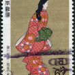 "Stock Photo: Stamp printed in Japan, shows picture of ""Beauty looking back"" by HishikawMoronobu, circ1991"