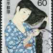 "A stamp printed in Japan, shows a painting ""Combing the hair"" by Hashiguchi Goyo, circa 1987 — Stock Photo"