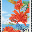 Royalty-Free Stock Photo: A stamp printed in Japan, dedicated to the Kyushu-Okinawa Summit, shows Ogomadara Butterfly and Erythrina variegata, circa 2000