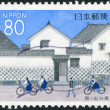Stock Photo: Stamp printed in Japan, Prefecture Yamaguchi, shows schoolchildren before Kikuya-family house, Hagi, circ1999