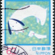 A stamp printed in Japan, dedicated to the Letter Writing Day, illustrates the bird brings a letter to the dog, circa 1992 — Stock Photo