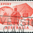 Royalty-Free Stock Photo: A stamp printed in Australia, is dedicated Importance of exports to Australian economy, is shown Globe, Ship, Plane and Map of Australia