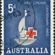 Stamp printed in Australia, is dedicated to 100th anniversary of International Red Cross, emblem of Red Cross, circ1963 — Stock Photo #12163141