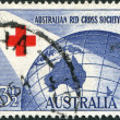 Stock Photo: Stamp printed in Australia, dedicated to 40th anniversary of AustraliRed Cross, represented Red Cross and Globe, circ1954