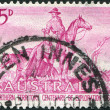"A stamp printed in Australia, is dedicated to Exploration of Australia's Northern Territory, the picture shows ""The Overlanders"" by Sir Daryl L - Stock Photo"