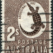A stamp printed in Australia shows Aboriginal Art, Crocodile, circa 1948 — Stock Photo
