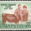 A stamp printed in Australia, dedicated to 25th anniversary of the club of young farmers, shows Boy and Girl with Calf, circa 1953 — Stock Photo