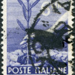 A stamp printed in Italy, shows Planting Tree, circa 1947 — Stock Photo #12163251